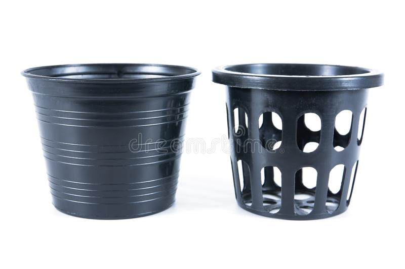 Two kind of black plastic flower pots on white background. Plastic flowerpot isolated. Background stock image