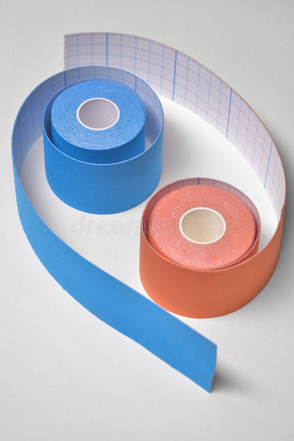 Two kinesio tape rolling arranged in tao shape royalty free stock images