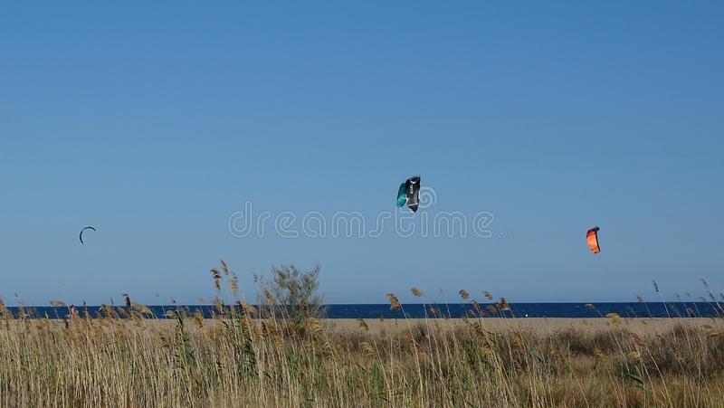 Two Kite surfers over the Mediterranean stock images