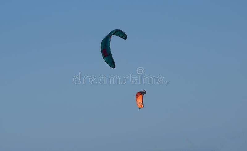Two Kite surfers over the Mediterranean stock photography