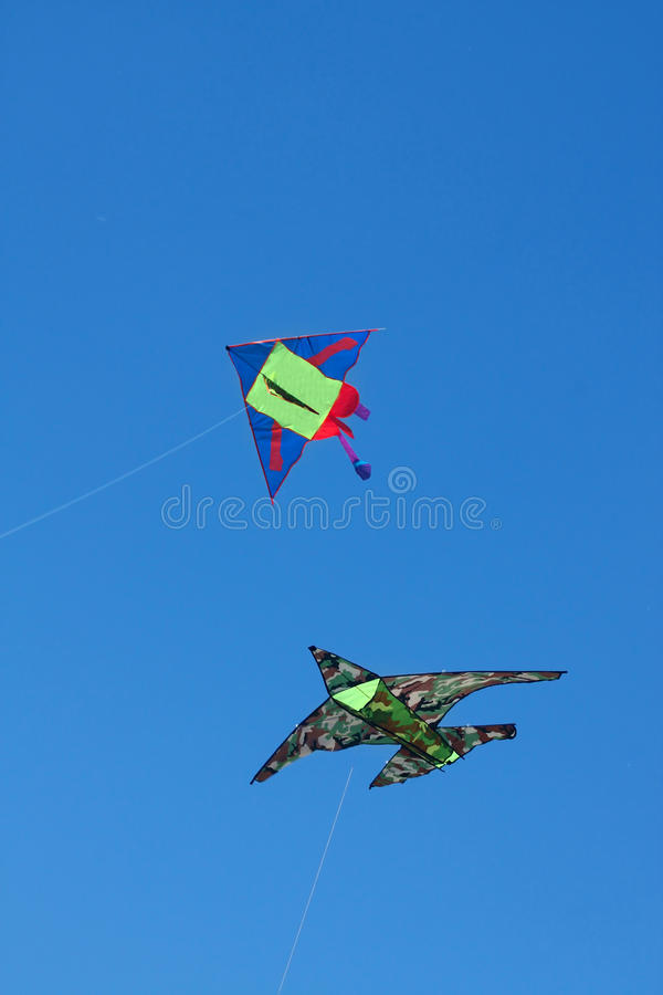 Two Kites Against A Blue Sky Royalty Free Stock Photos