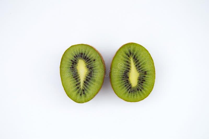 Two kiwis on a white background. Two halves of kiwi. Horizontal photo. Top viev. royalty free stock photos