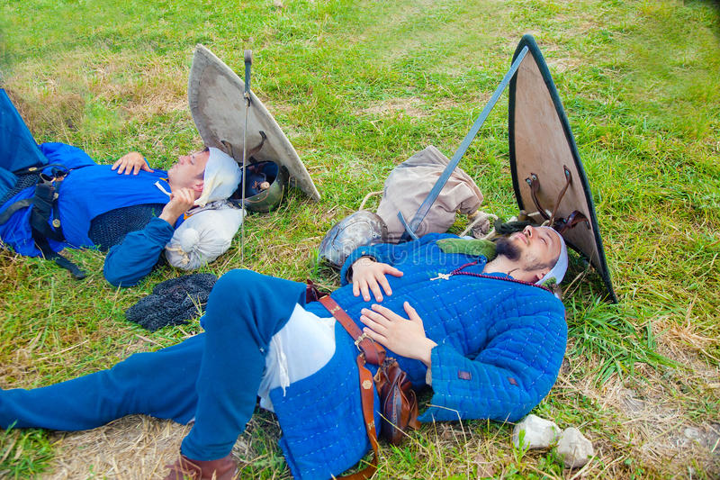 Two knights asleep before battle royalty free stock image