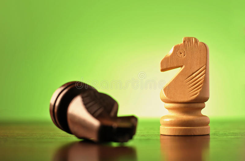 Two knights in a game of chess royalty free stock image