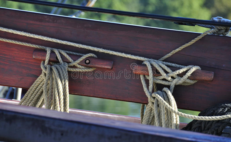 Two knots. At sea - detail of a vintage sailer with two knots royalty free stock images