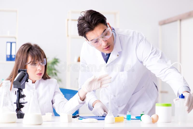 The two lab doctor testing food products royalty free stock image
