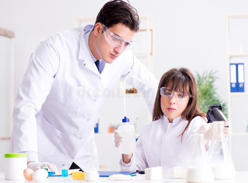 The two lab doctor testing food products royalty free stock photo
