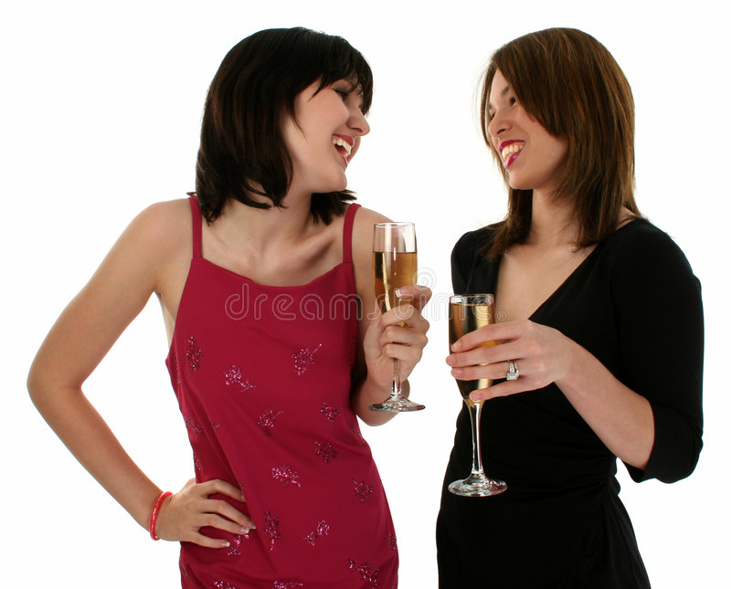 Two Ladies at a Party. Upper body shot of two girls drinking at a party. Shot with a Canon 20D stock photos