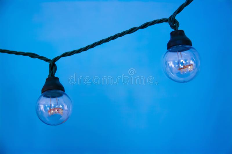 Two lamps hanging in a garland. royalty free stock photo