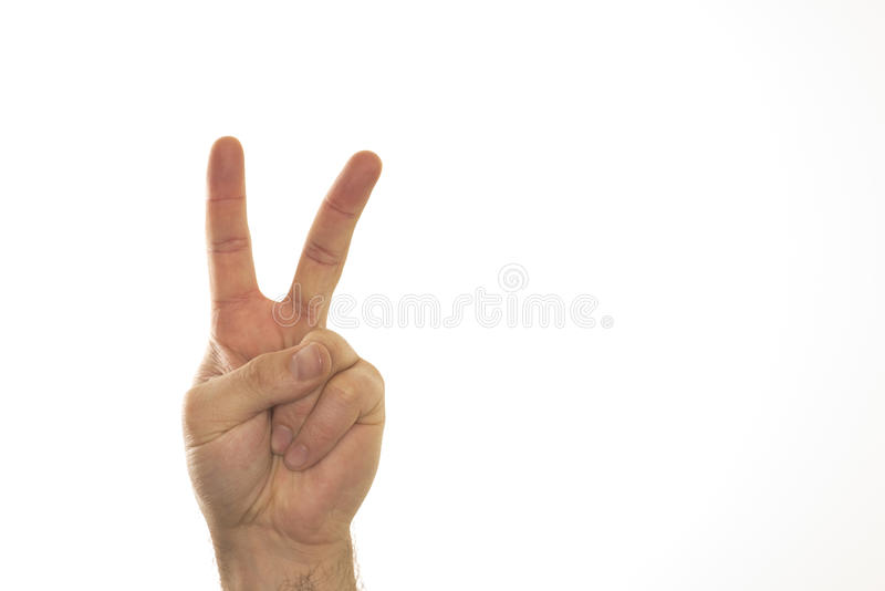 Two fingers of hand against white background royalty free stock photo