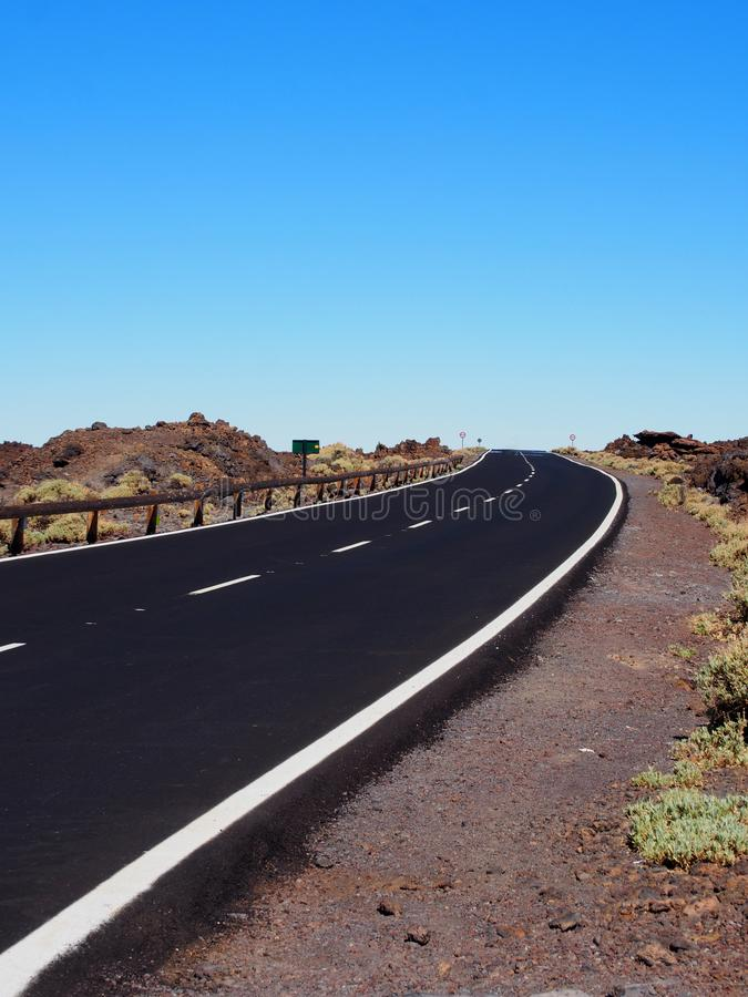 Two lane empty road with desert scenery stock images