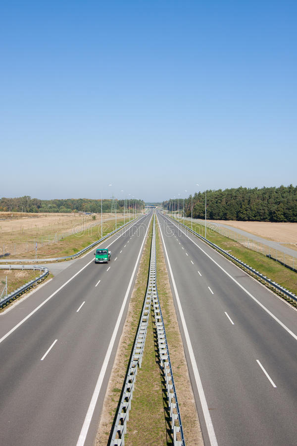 Two-lane highway with cars stock photo