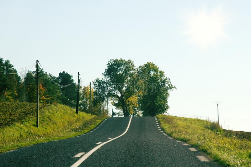 Two-lane highway in the hills of France stock image