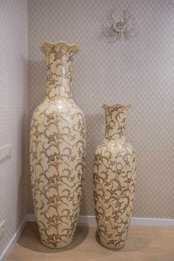 Two Large Antique Beige Vases Pitcher Standing In The Interior Of