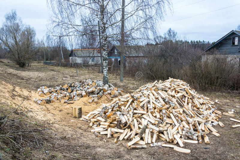 Two large piles of birch firewood. royalty free stock photos