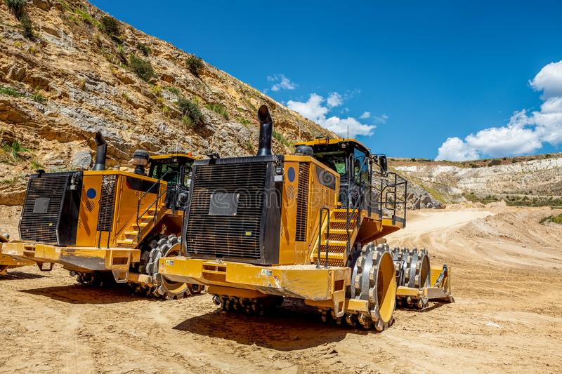 Two large yellow industrial bulldozers. stock photo