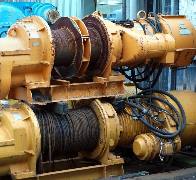 Two Large Yellow Winches