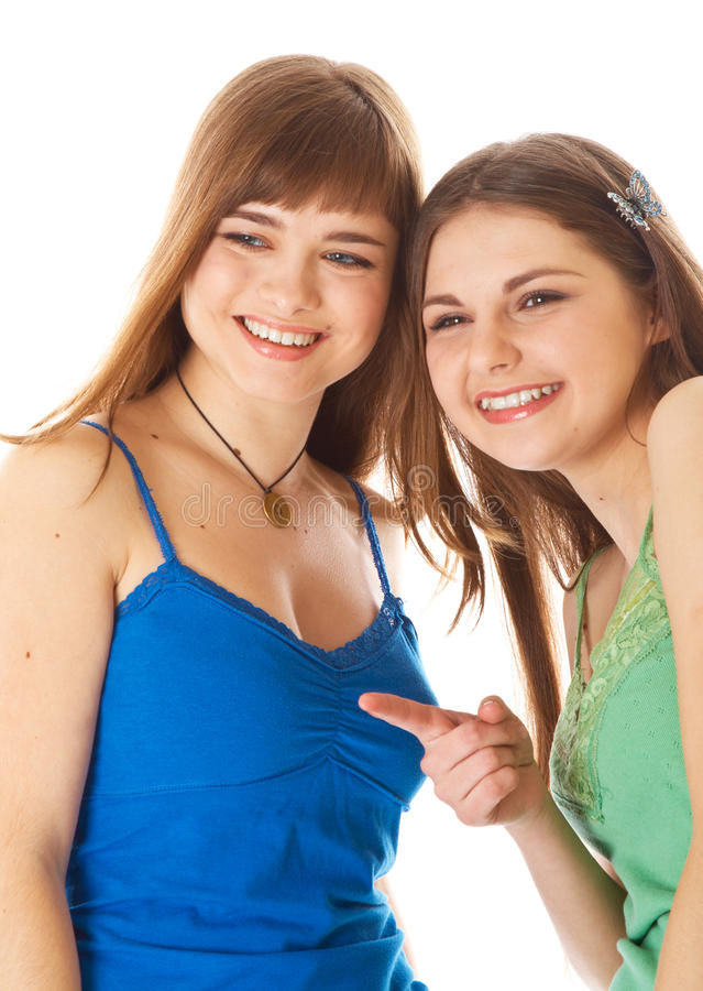 Two laugh teenage girls. Isolated on white background stock image