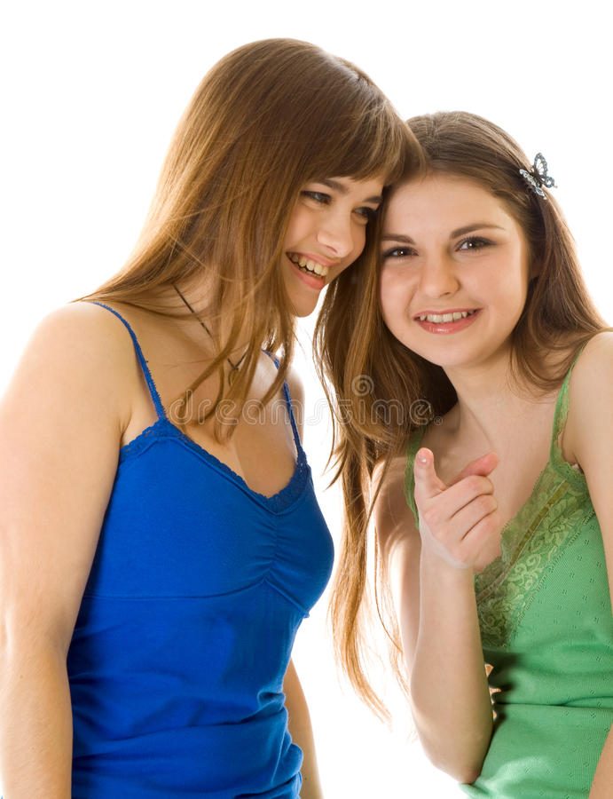Two laugh teenage girls. Isolated on white background royalty free stock image