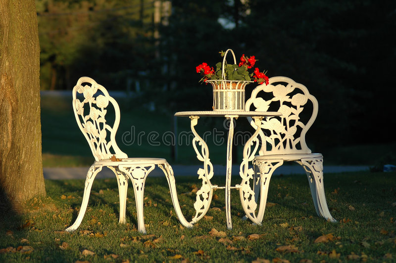 Download Two Lawn Chairs And A Table Outdoors Stock Photo - Image: 1439866