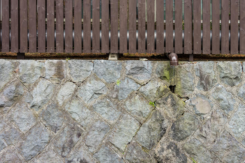 Two layers of fence with drain pipe stock images