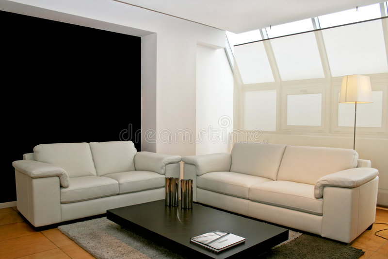 Two leather sofas. Interior shot of living room with two leather sofas stock photo