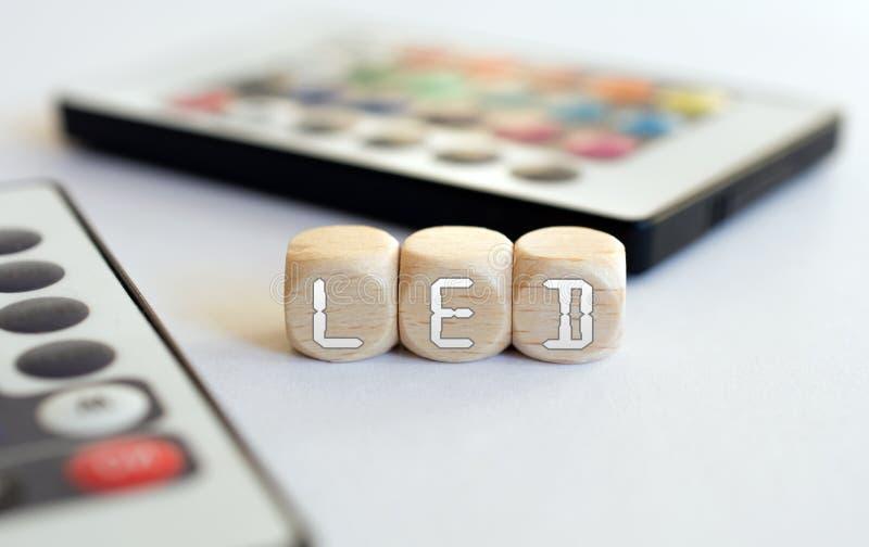 Two LED Remotes With LED-Cube Acronym stock photo