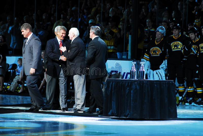 Two Legends Greet. Boston Bruins legend and hockey Hall of Famer Bobby Orr greets his old coach, Hall of Famer Milt Schmidt before the Bruins played the Toronto royalty free stock photo