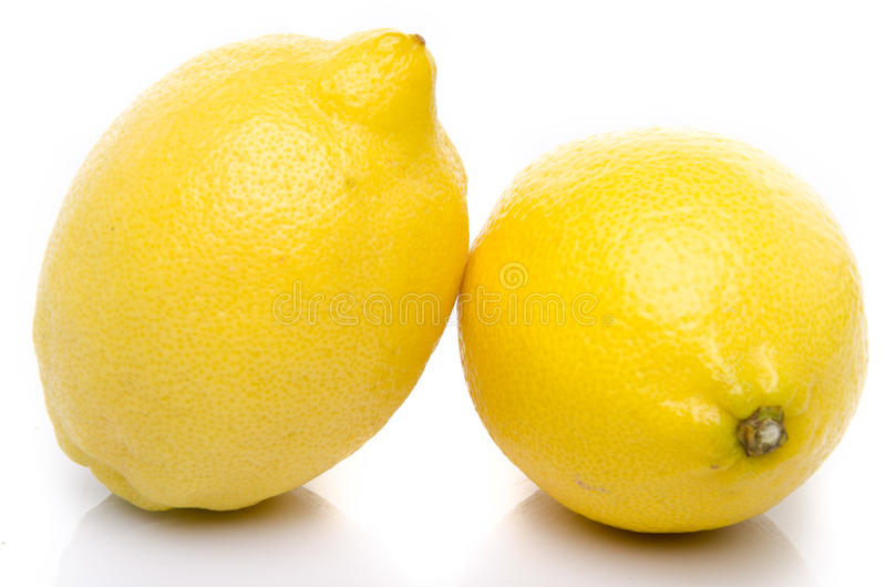 Two lemons. Isolated on white royalty free stock photos