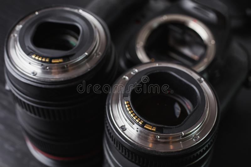 Two lenses and a camera mount. Contacts of the microprocessor on the lens for connection to the camera royalty free stock photo