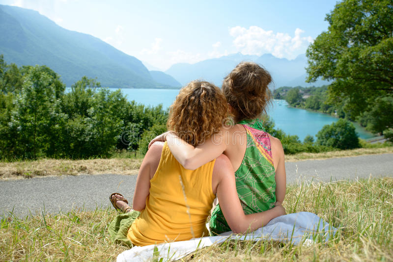 Two lesbians in nature admire the landscape. Two lesbians in nature admire the lake of Annecy stock photography