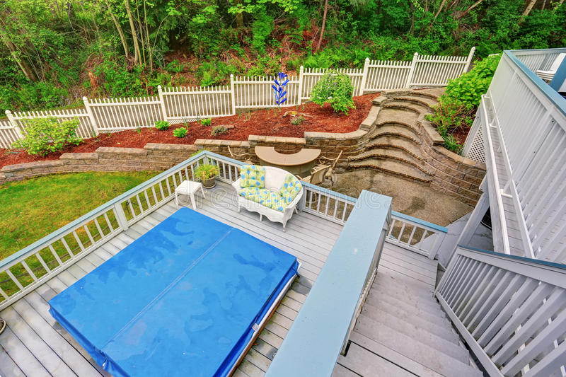 Download Two Level Backyard Deck With Jacuzzi On The First Floor And Patio  Area On The