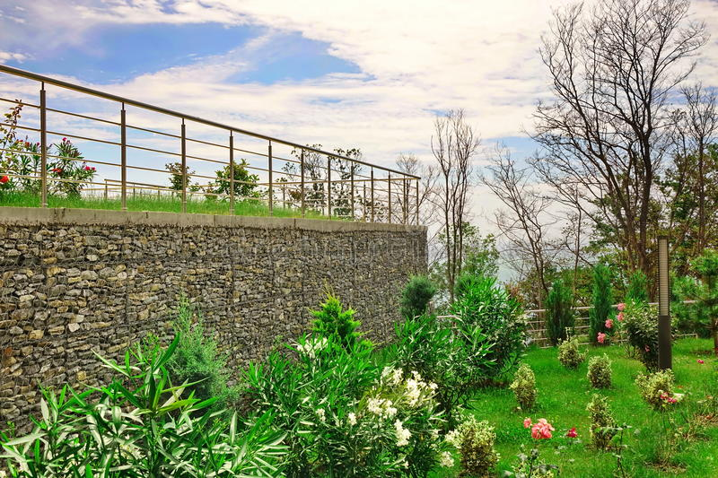 Two Level Garden Terrace With Garden And Wall From Gabions stock photos