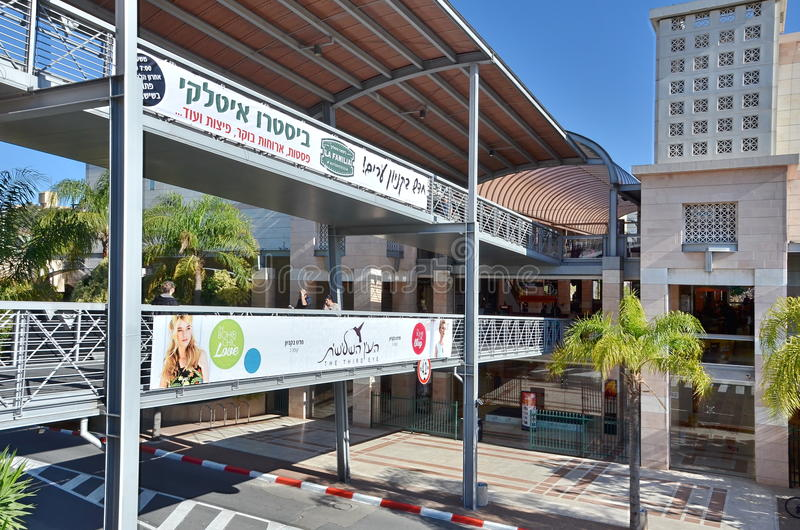 Two-level pedestrian bridge. KFAR SABA, ISRAEL - MARCH 28, 2014: A two-level pedestrian bridge connecting two buildings in Kfar Saba, a suburb of Tel Aviv stock images
