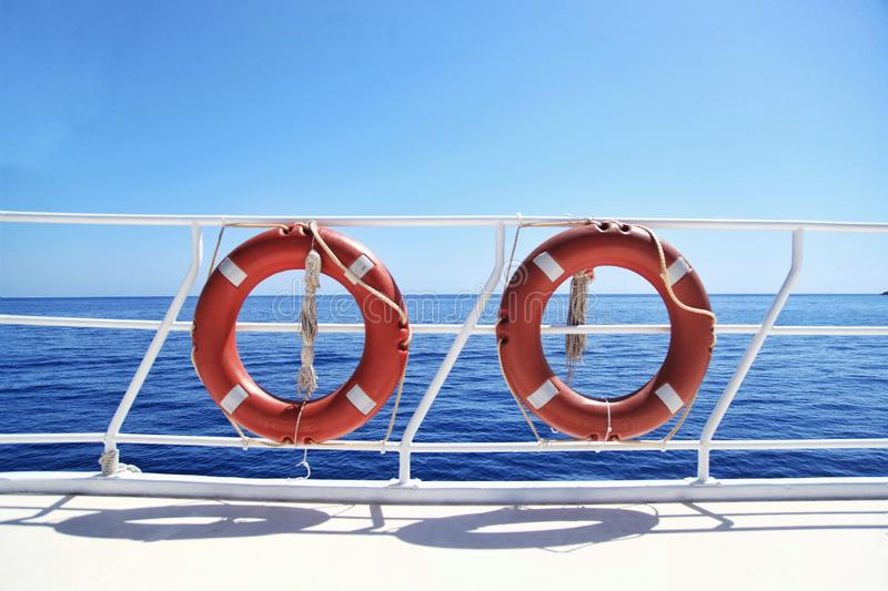 Two lifebuoys on the background of the sea, vacation, beach, yacht, tan, safety, r royalty free stock photos