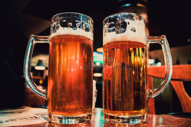 Two light beers are full on the table.  royalty free stock photo