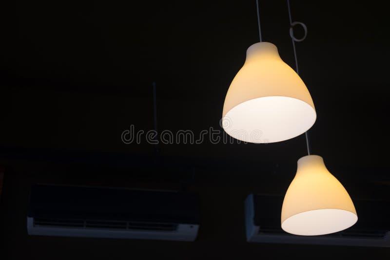 Light bulb lamp hanging in dark room stock photo image of energy download light bulb lamp hanging in dark room stock photo image of energy ceiling aloadofball Choice Image