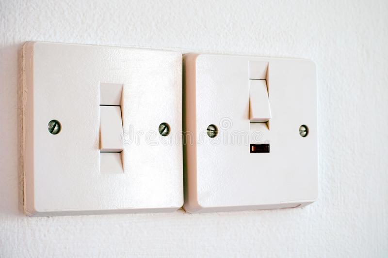 Two Light Switches On White Wall. Stock Image - Image of switch ...