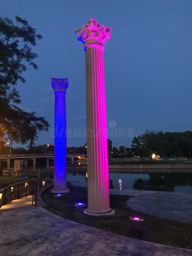 Two lighted pillars by water royalty free stock image
