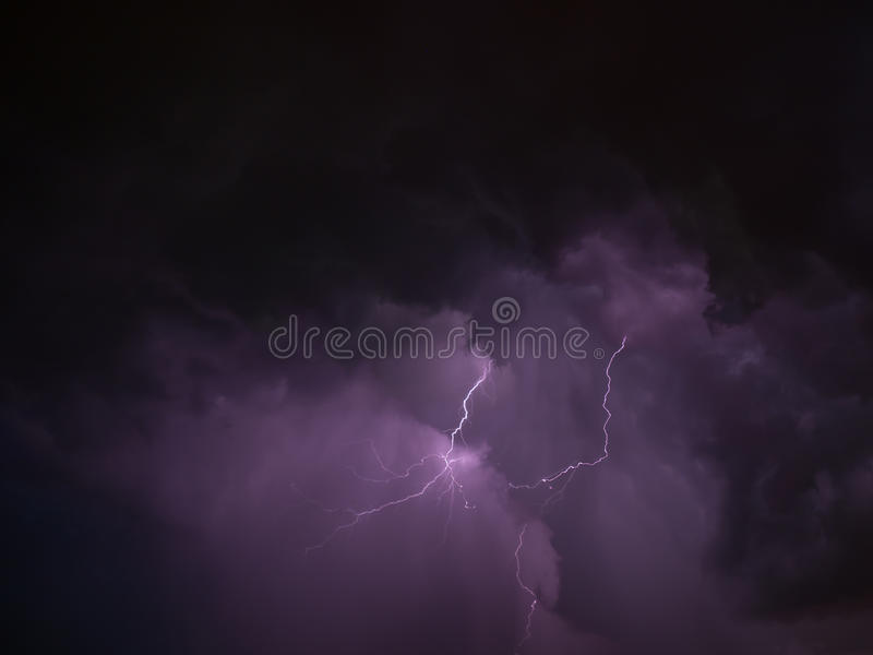 Two lightning and violet skies during thunderstorm. In summer stock images
