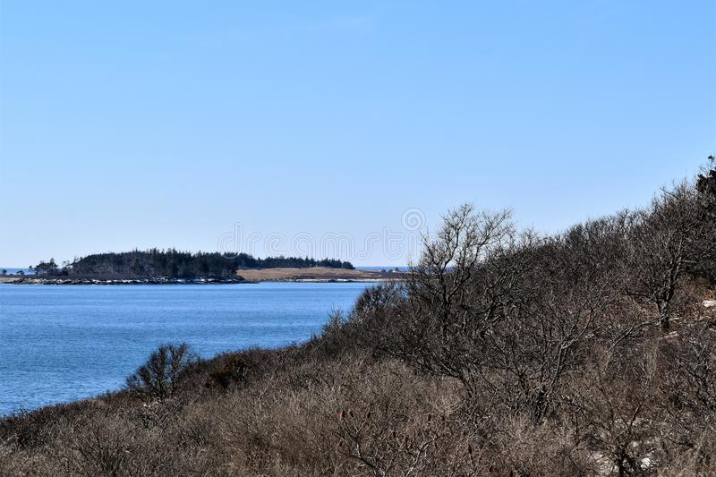 Two Lights State Park and surrounding ocean view on Cape Elizabeth, Cumberland County, Maine, ME, United States, US, New England. Cloudy winter landscape view of royalty free stock image