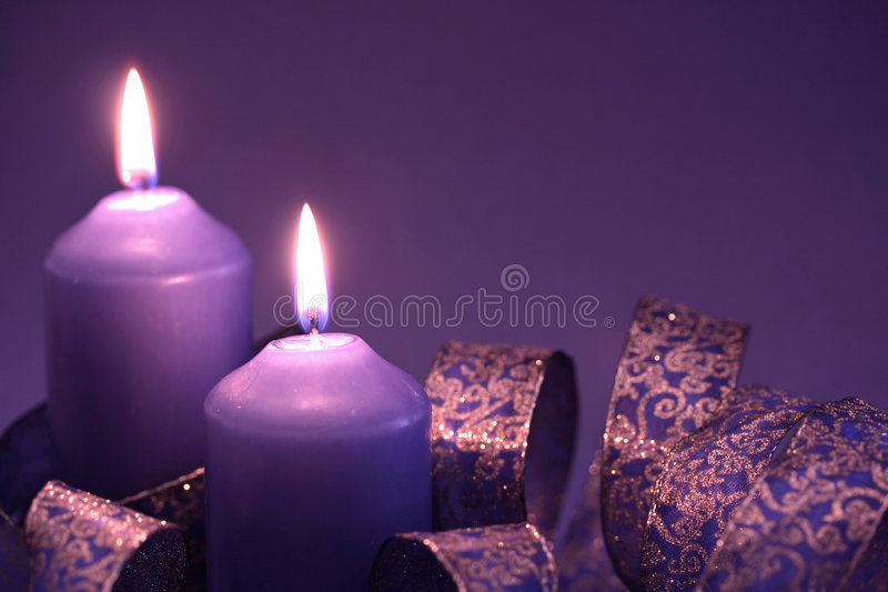Two lilac candles royalty free stock photos