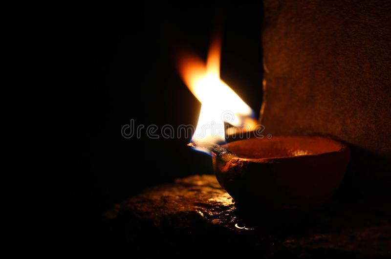 Two lit oil lamps made out of clay royalty free stock photography