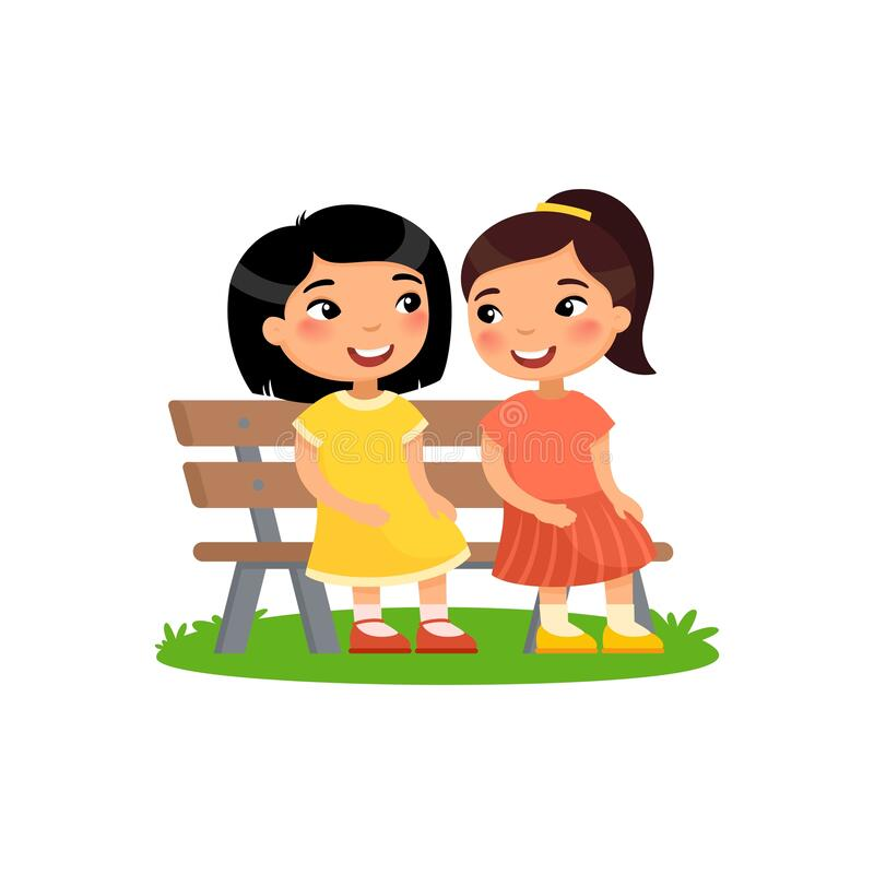 Free Two Little Asian Girls Are Sitting On Bench. Girlfriends Are Talking. Stock Image - 189771921