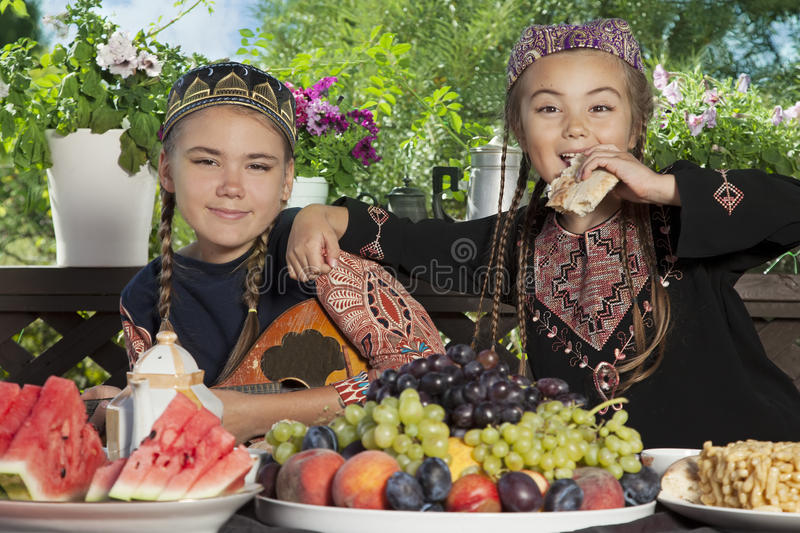 Two little Asian girls have breakfast royalty free stock photo