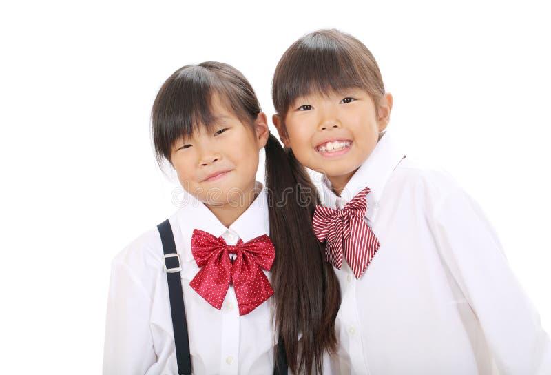 Two Little Asian Schoolgirls Stock Photos