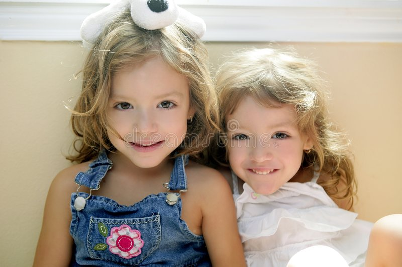 Two little beautiful toddler twin sisters stock photo