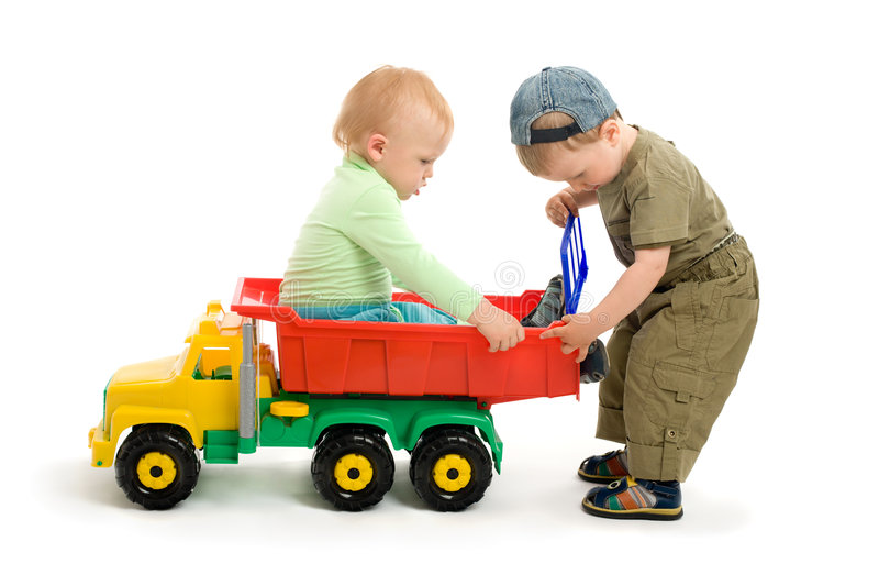 Two little boys play with toy truck royalty free stock images