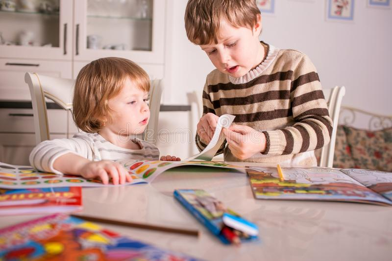 Two little children learning and playing stock photos