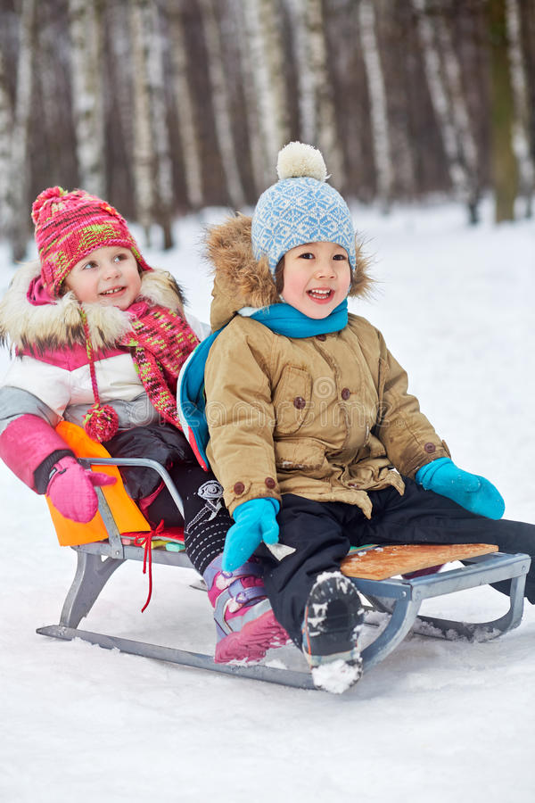 Download Two Little Children Sit In Sledge Stock Photography - Image: 33336172